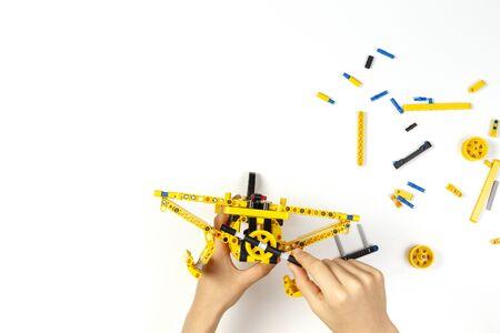 Child hands making construction plane. Robotic, learning, technology, stem education for children background Reklamní fotografie - 133483875
