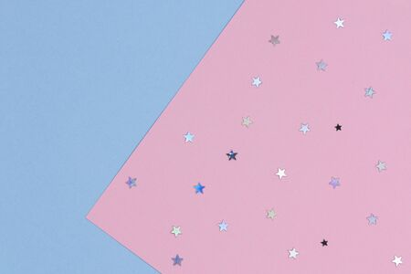 Abstract geometric festive background. Light blue and pastel pink with glitter stars paper background. Top view 写真素材