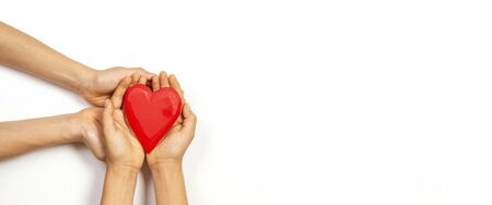 Hands holding red heart over white background. Love, healthcare, family, insurance, donation concept