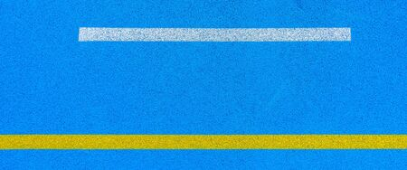 Colorful sports court background. Top view blue field rubber ground with white and yellow lines outdoors