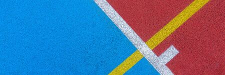 Colorful sports court background. Top view to red and blue field rubber ground with white and yellow lines outdoors Stockfoto - 134568654
