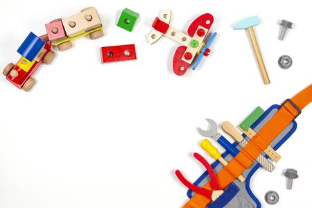 Kids toys background. Wooden train, construction plane and toy tools kit on white background. Top view, flat lay Stockfoto - 134568669