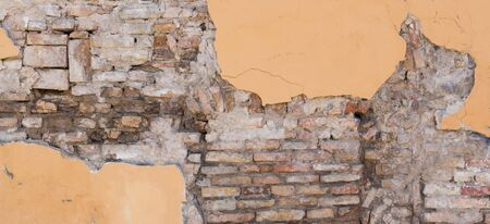 Background texture from brick wall with damaged cracked plaster Stockfoto