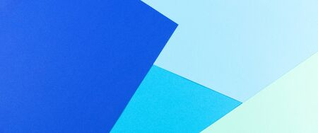 Color papers geometry flat composition background with blue tones Stockfoto