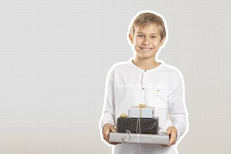 Happy boy holding stack paper wrapped present gift boxes. Magazine collage style with light grey color background. Holidays, Christmas concept Stockfoto - 134568718