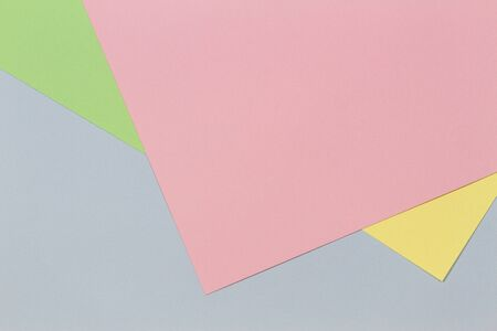 Geometric pink, light blue, yellow and green color paper background