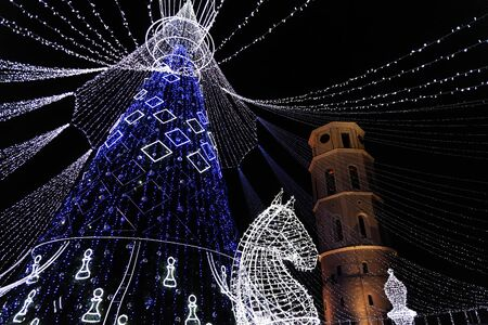 Vilnius, Lithuania - December 9, 2019: Beautiful decorated Christmas tree, Christmas market in Vilnius Cathedral square, Lithuania