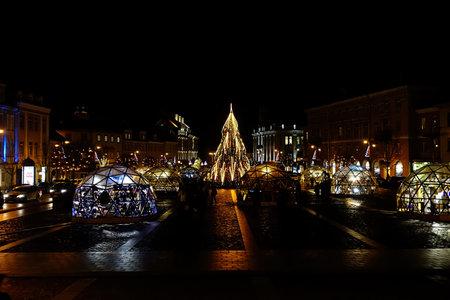 Vilnius, Lithuania - December 09, 2019: Christmas tree and Christmas market in Town Hall, Vilnius, Lithuania