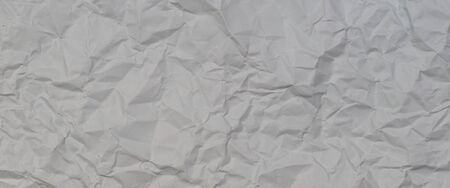Light grey crumpled wrinkled paper texture background
