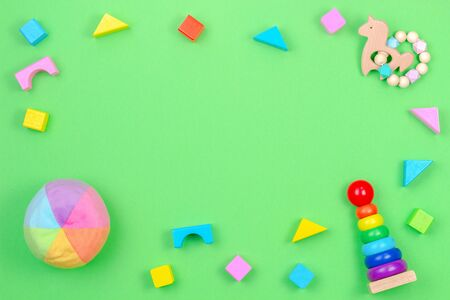 Baby kids toys background frame on light green background. Top view, flat lay, copy space for text Reklamní fotografie