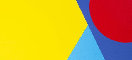Abstract geometric shape yelllow, blue, red color paper background.