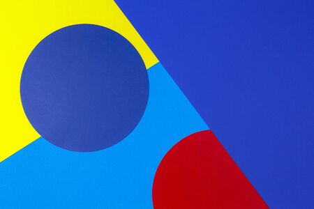 Abstract colored paper texture background. Minimal geometric shapes and lines in yellow, red and navy blue colours.