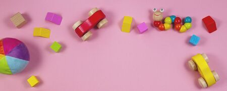 Baby kids toys banner background with colorful wooden and stuffed toys Reklamní fotografie