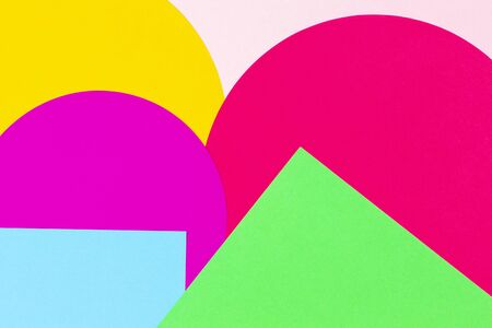 Texture background of fashion papers in memphis geometry style. Yellow, blue, green, pink colors. Top view