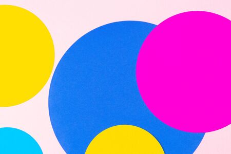Texture background of fashion papers in memphis geometry style. Yellow, blue, magenta, pink colors. Top view