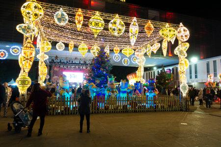 Benidorm, Spain - December 22, 2019: People enjoy Christmas activities in Christmas Square at Plaza del Ayuntamiento de Benidorm, Spain
