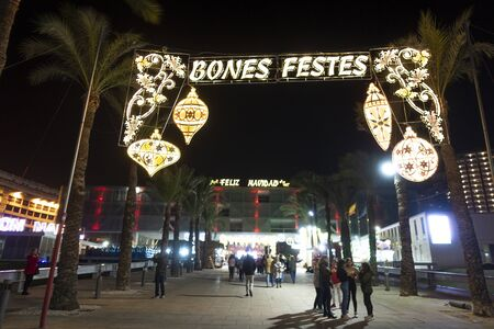 Benidorm, Spain - December 22, 2019: People enjoy Christmas activities in Plaza del Ayuntamiento in Benidorm city, Spain