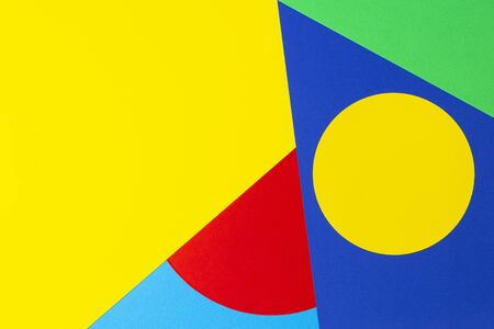 Abstract geometric shape yelllow, blue, red, green color paper background