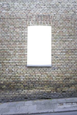 Mock up. Blank vertical billboard, poster frame, advertising board on the brick wall. Stockfoto
