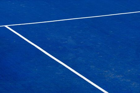 Blue paddle tennis court field with white lines background