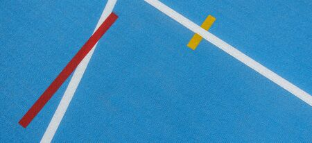 Sport background. Blue running track with white lines, yellow and red mark in sport stadium
