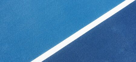 Colorful sports court background. Top view light blue and navy blue field rubber ground with white line outdoors.