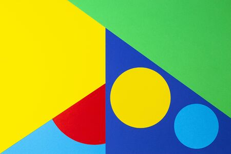 Abstract geometric shape yelllow, blue, red, green color paper background.