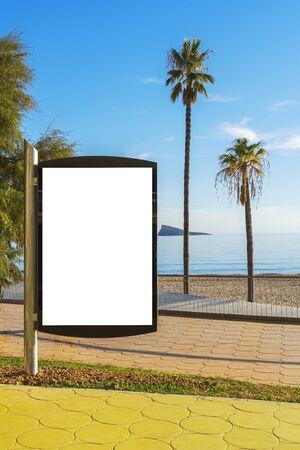 Blank billboard outdoors, outdoor advertising, public information placeholder board near the beach sea Reklamní fotografie