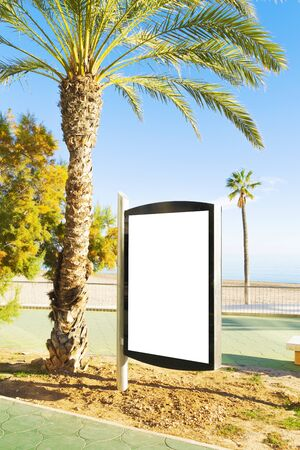 Blank billboard outdoors, outdoor advertising, public information placeholder board near city beach by the sea
