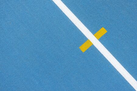 Sport background. Blue running track with white lines and yellow mark in sport stadium. Top view Reklamní fotografie