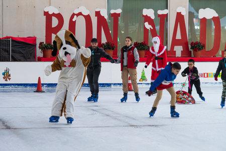 Benidorm, Spain - December 25, 2019: People having fun on skating rink. Tradicional Christmas city in Benidorm, Spain