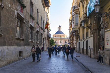 Valencia, Spain - January 2, 2020: People walking in Carrer dels Cavallers street, in old town of Valencia, Spain