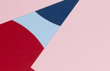 Abstract colored paper texture background. Minimal geometric shapes and lines in pastel blue, light pink, red and navy colours. Stockfoto