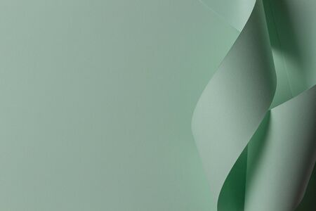 Abstract geometric shape green color paper background