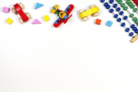 Baby kids toys frame on white background. Top view, flat lay. Copy space for text