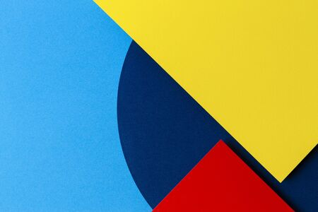 Abstract colored paper texture background. Minimal geometric shapes and lines in light blue, navy, red and yellow colours