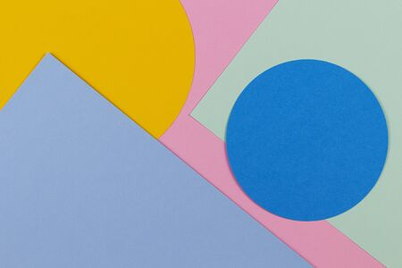 Abstract colored paper texture background. Geometric shapes and lines in blue, light green, yellow, pastel pink colours