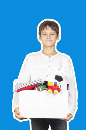 Donation concept. Kid holding donate box with clothes, books, school supplies and toys. Magazine collage style with blue color background