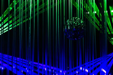Green and blue laser beams on black background. Laser show rays stream. 写真素材