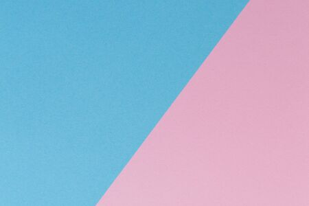 Soft pink and light blue pastel colored paper background.