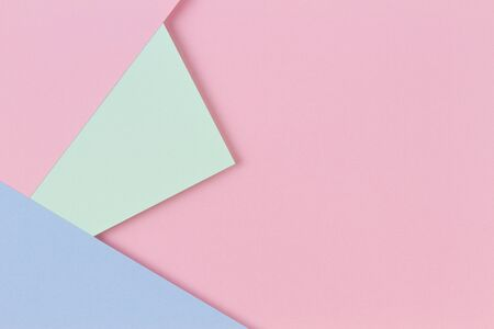 Abstract colored paper texture background. Minimal geometric shapes and lines in pastel pink, light blue and green colours.