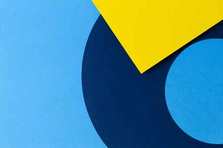 Abstract colored paper texture background. Minimal geometric shapes and lines in light blue, navy and yellow colours. 写真素材