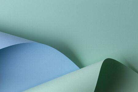 Abstract geometric shape light green and blue color paper background 写真素材