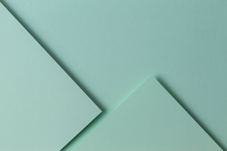 Abstract monochrome creative paper texture background. Minimal geometric shapes and lines in light green color. 写真素材