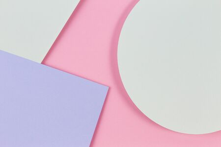Abstract colored paper texture background. Minimal geometric shapes with shadows, circles and lines in pastel pink, light blue and green colours.