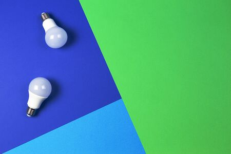 Light lamp bulbs on blue navy and green background
