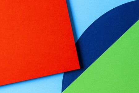 Abstract colored paper texture background. Minimal geometric shapes and lines in red, light blue, navy, green colors