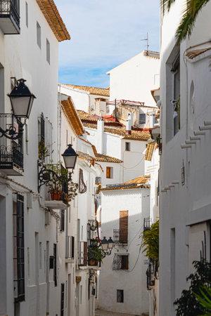 Altea, Spain - March 05, 2020: Beautiful view of authentic Altea old town street. Altea, province of Alicante, Mediterranean coast, Costa Blanca, Valencian Community Editoriali
