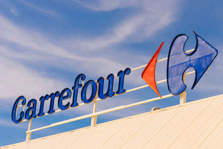 Finestrat, Spain - March 10, 2020: Carrefour logo in Finestrat Spain. Carrefour is one of the largest hypermarket chains in the world