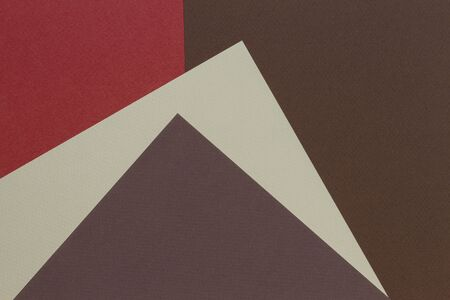 Color papers geometry composition background with beige and brown tones.